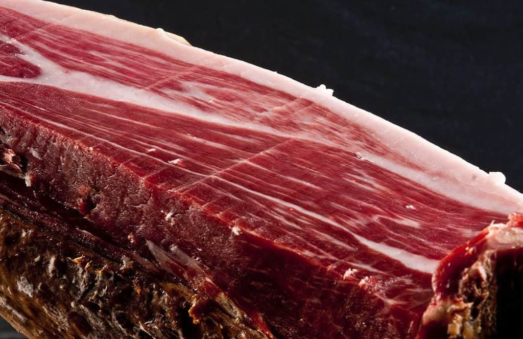 Good cured ham has thin strings of intra muscular fat