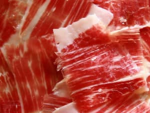 Cured ham cut in thin slices